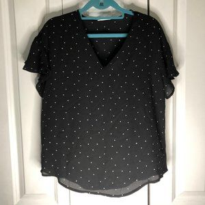 Black blouse with polka dots